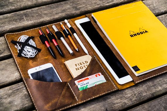 This handmade leather padfolio is compatible with iPad Pro 12,9 & Surface Pro and all Letter size and A4 size notebooks.It protects and organize your all EDC essentials.  This leather portfolio has 4 elastic pen / pencil loop and an Apple Pencil holder.Also there are two credit card slots, two small pockets for your phone and your small notebooks, an elastic storage for cables, earphone cords or power adapter.  It comes with two different elastics to attach the notebooks.You can use ...