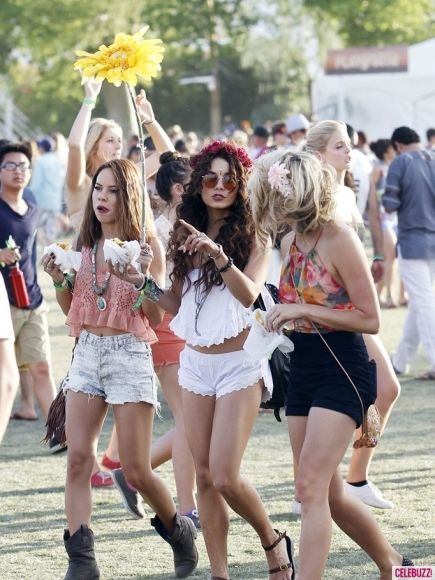 every year i look forward to seeing what ridiculous outfit Vanessa Hudgens wears to cochella..this one is not crazy but the over sized sunflowers brings all the crazy back..