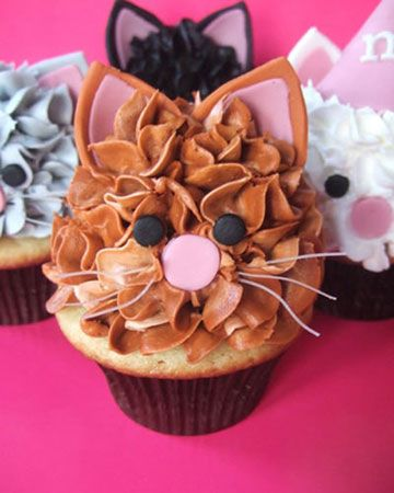 Cat Cupcakes  Our Cutest Cupcakes photo contest for 2010 resulted in hundreds of very creative and truly unique entries. Take a look at the 20 winners' cupcakes.  These cupcakes will appeal to all cat lovers. They are 3GirlsandaCupcake's signature confection: Vanilla cupcakes with orange-vanilla buttercream and marshmallow fondant ears, eyes, and noses, plus clear noodles for whiskers.