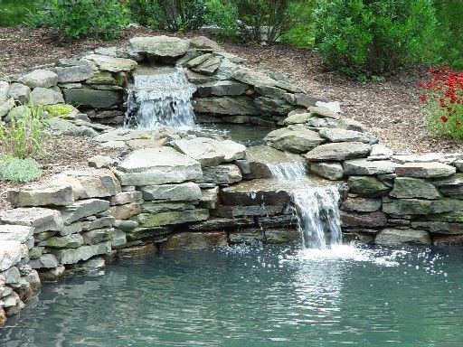 NATURE'S SWIMMING HOLE surrounded by stone wall with waterfall... natural…
