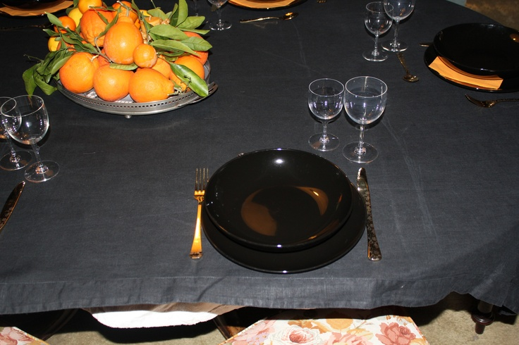 Black linen table cloth, extra black glossy dishes, 70s Baccarat glasses and Liberty citrus tray