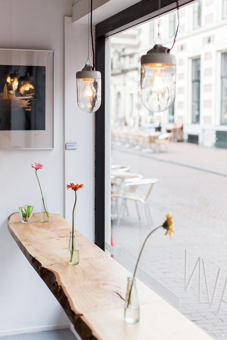 industrial lights add a rustic elegance to the space - Multi Cafe Decoration