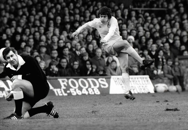 Duck ref! Peter Lorimer leathers a facebreaker at the referee