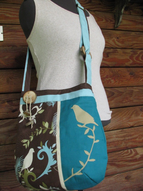 Bird Enchantment shoulder bag in blue and brown with adjustable strap and 6 pockets. $62.00, via Etsy.