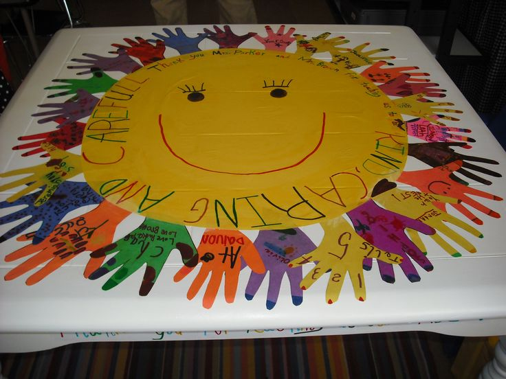 Kindergarten graduation. I repurposed this table as a gift for my son teachers. I had all the kids decorate one of their hands and cut them out of construction paper. Then I had my son write their slogan around the sun. Thanks to the teachers for teaching us to be KIND, CARING, AND CAREFUL. On the sides of the table I had my son write on construction paper ABC and 123. I mod podged the whole table a couple of coats so it would be sealed good and could be wiped down on a daily bases.