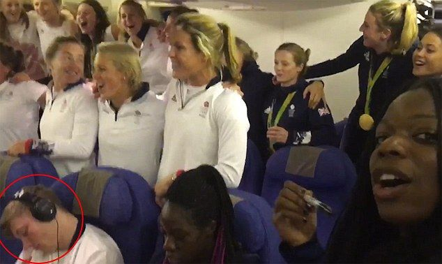 Team GB were clearly in good spirits as they blasted out the national anthem  on the plane home from Rio - but gymnast Nile Wilson (circled) managed to sleep through the entire thing