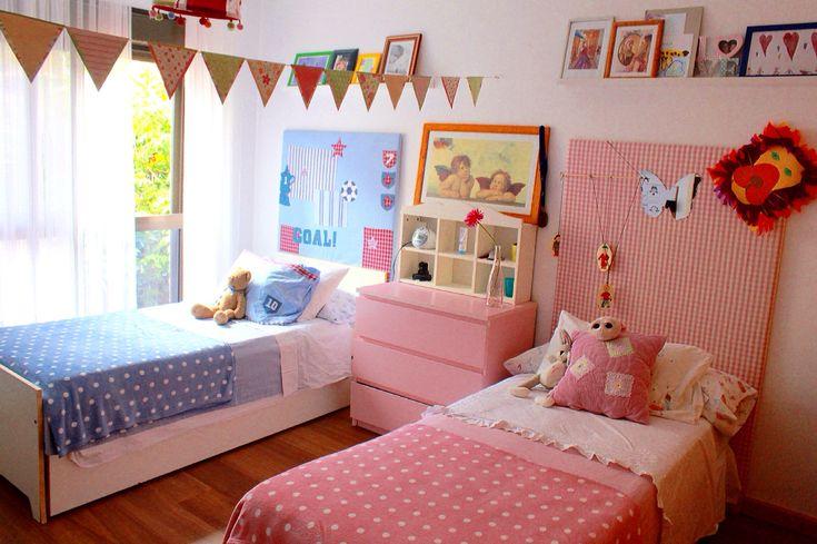 Boy/girl bedroom: flag banner acts as subtle divider, bed boards distinguish b/g