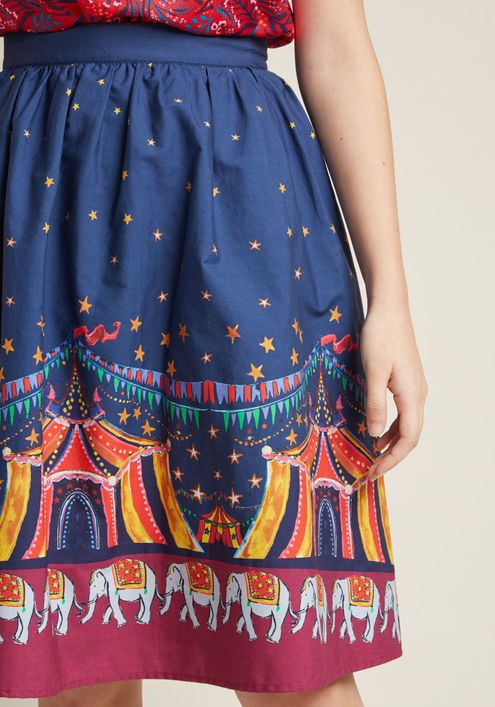Charming Cotton Skirt with Pockets in Circus - Whoever believes staple pieces should only be solid needs to meet the sweet versatility of this navy blue skirt! A cotton offering from our ModCloth namesake label, this A-line makes it a pleasure to pair its belt loops, hidden pockets, and colorful big top print with your pieces both new and cherished.