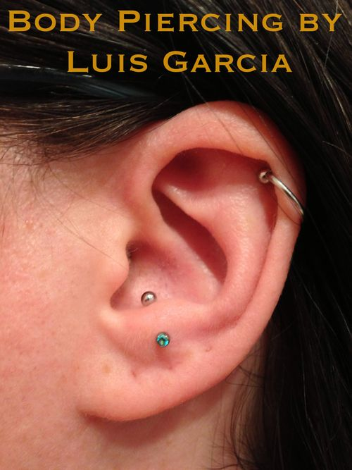 Healed anti-tragus piercing with 16ga Anatometal curved barbell with 2mm prong set mint green CZ