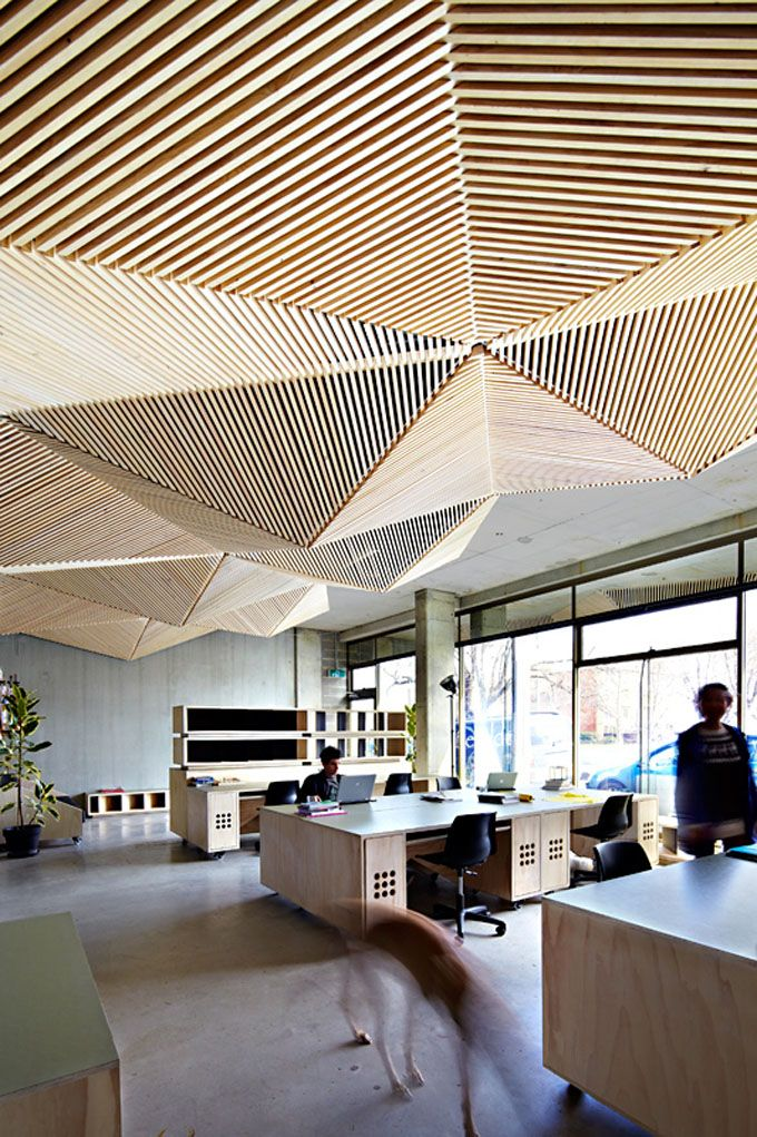 Assemble Studio; pine batten-and-stud latticework ceiling, multiple functions: design aesthetic, concealing pipes, improved acoustics