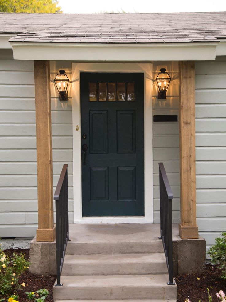 I like the dark door with the light siding and white trim. Plus the wood clad pillars give it a touch of character and classic appeal.