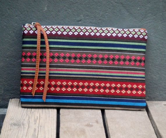 Check out this item in my Etsy shop https://www.etsy.com/listing/236503405/ethnic-boho-fabric-pouch-leather-details