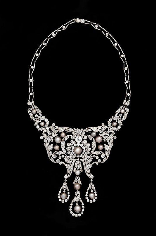 Platinum, diamond and pearl necklace.