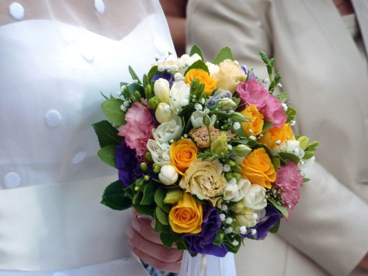 wedding bouquet with pink, yellow, purple and white flowers