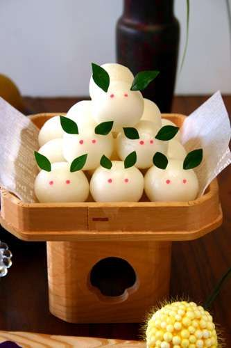 "The Japanese see a rabbit in the moon.  Pounded rice ""dango"" balls are traditional moon-gazing fare"