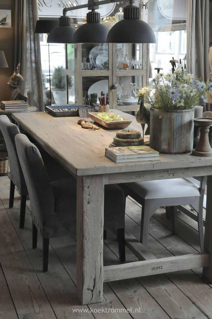 Chunky dining table with iron light fixtures
