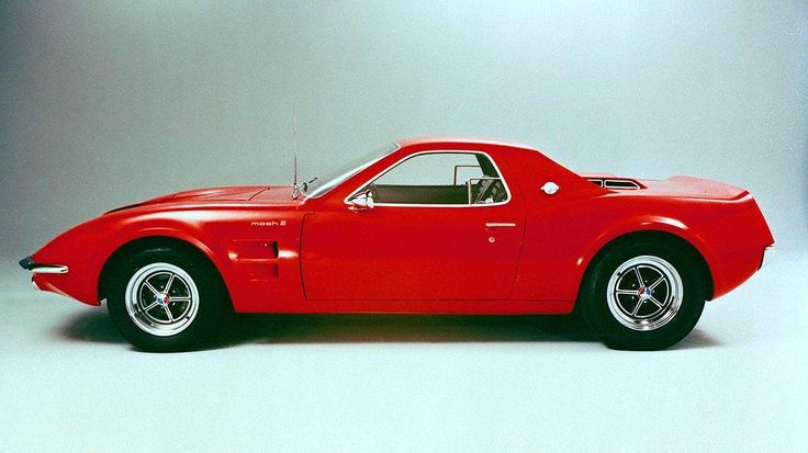 Even with the engine moved amidships, the Mach II concept retained the long hood, short rear proport... - Ford Motor Company
