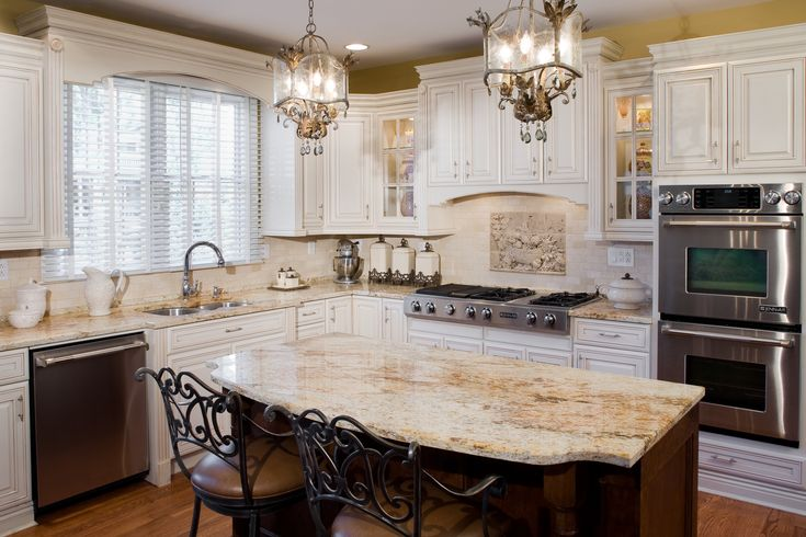 Tuscan antique white kitchen cabinets jennair appliances for Antique white kitchen cabinets with dark island