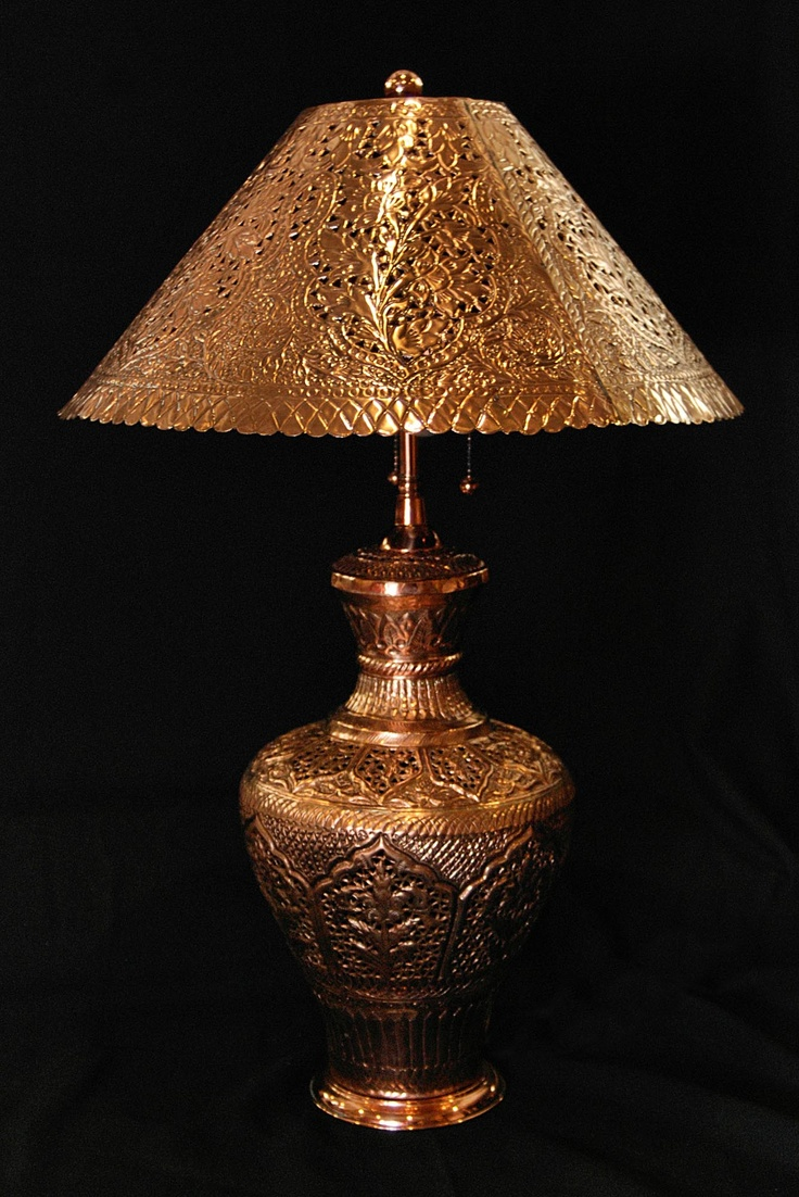 Persian Two-Light Copper Lamp with Shade: Embossed & engraved scenes framed by various geometrical designs. Shade decorated with engraved & pierced flowers & vines / http://www.beauxartsgalleria.com/Persian_Two-Light_Copper_Lamp_with_Shade.html