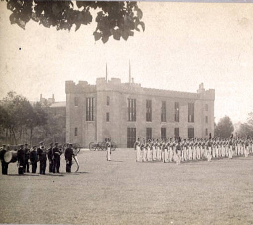 VMI Corps and old Band in front of Barracks, ca. 1890 :: VMI Archives Photographs Collection. The band used to be made of hired musicians.