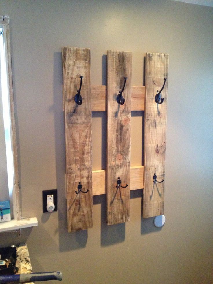 Another easy DIY for recycled pallets. Get a pallet, cut to size then attach cute hooks available from hardware stores