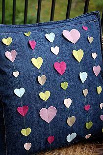 Various sized hearts horizontally on a plain cushion - beautiful.