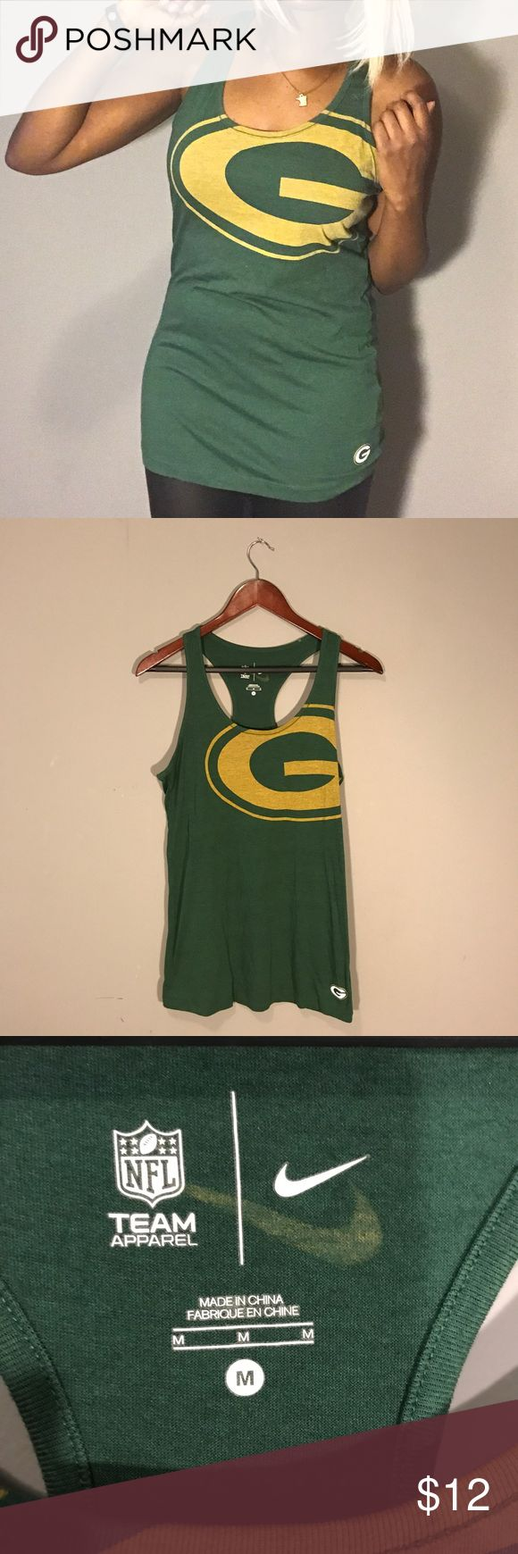 NFL Apparel | Green Bay Packers Racerback Tank Cheese heads unite! Green Bay Packers racerback tank top. Longer length. Small imperfection on interior neckline (cannot be seen when worn). Size Medium. Smoke free, pet free home! Tops Tank Tops