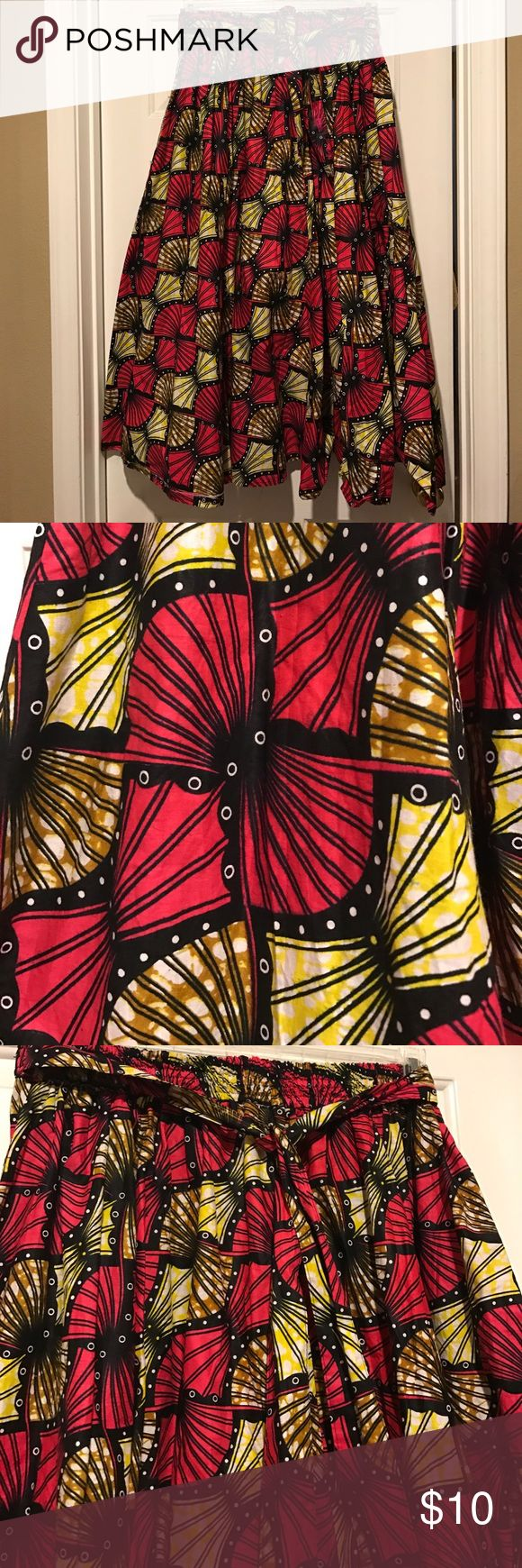 African Print cotton maxi skirt (nwt) This African print maci skirt will have all eyes on you this summer. Elastic waistband band, pockets and waist tie. It's free size. I am a true size 18 and it fits fine. Skirts Maxi