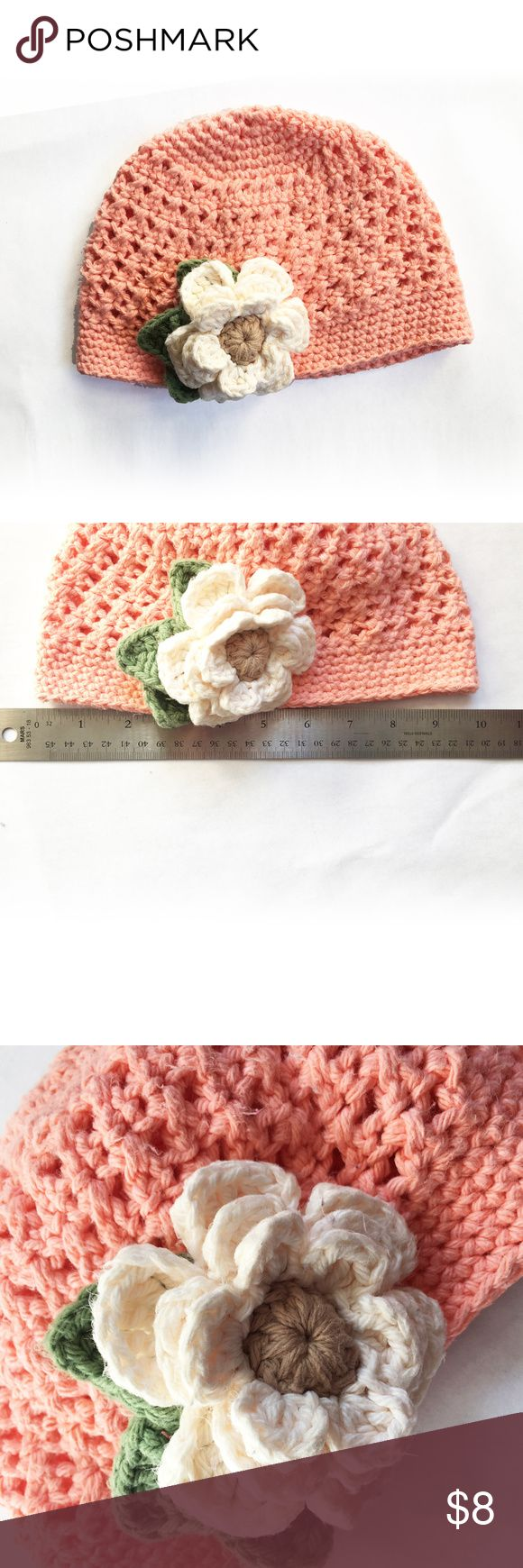 """Crochet Girl Hat with Flower This hat is crocheted using a unique cross stitch that creates a mesh fabric that is perfect for warmer and cooler months. It has been made with soft 100% cotton yarn so that it won't be that """"itchy hat"""" that she won't wear. This is a used beanie in good condition. Measures about 10 across when flat. Peach color hat with white flower and green leaves. Accessories Hats"""