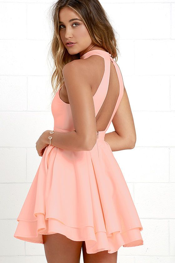 When the spotlight falls on you, you'll be grateful to be donning a number as cute as the Dress Rehearsal Bright Peach Skater Dress! Medium-weight woven fabric, in a vibrant peach hue, falls from a halter neckline into a princess seamed bodice with wide arm openings. Neckline fastens at back above a cutout before meeting a banded waist and full, skater skirt. Hidden back zipper with clasp. PLEASE NOTE: Dress may appear brighter in person than on monitor.