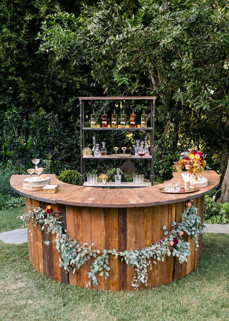 Wooden, Curved Drinking Bar, for an Out-Door Wedding. Easy to Replicate, & You Can Add Your Own Floral Arrangements Around the Exterior! Super Cute!