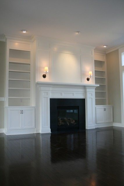 Shows our fireplace with matte black surround + white mantle