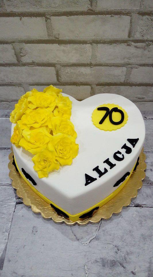 Tort na 70 urodziny z żółtymi kwiatami
