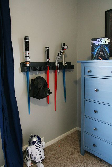 Perfect for Brett: Lightsaber orangizer made from a outdoor tool holder. Quite Contrary: Completed Star Wars Room