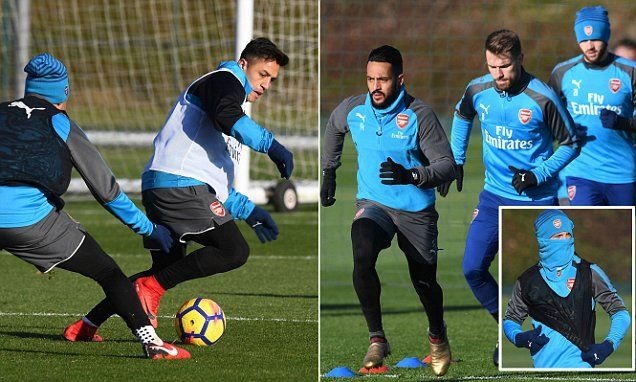 Arsenal stars wrap up warm ahead of Manchester United game