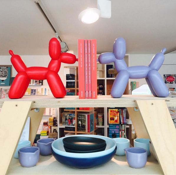Jazz up your bookshelf with these fun Balloon Dog Bookends // Sturdier than your average balloon animal // Available in teal, red and orange // Also pictured, some of our gorgeous #bisonhome ceramics