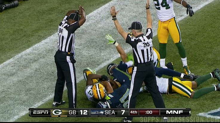 The stunning ending in Seattle. One ref raises his arms to signal touchback, the other ref sees him raising his arms and signals touchdown. Seahawks win, Packers lose. -- Ladies and gentlemen, your 2012 replacement officials! - #NFL #packers #seahawks #football #refs #greenbay #seattle