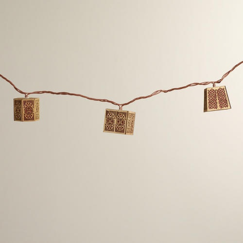 Carved Wood String Lights  Are string lights for interiors tacky? I kinda like these.