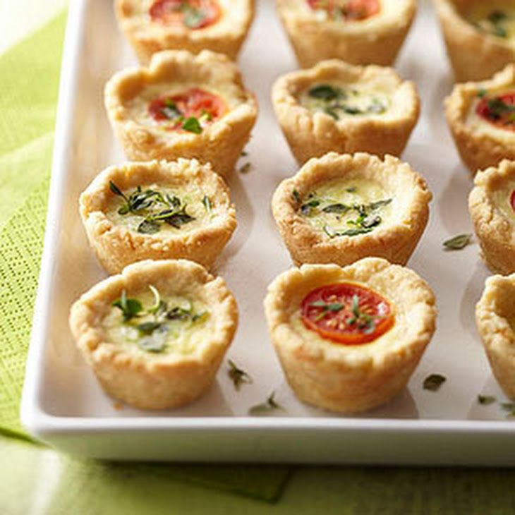Mini Party Quiches Recipe with nonstick spray, all-purpose flour, grated parmesan cheese, salt, olive oil, cold water, eggs, milk, ground black pepper, shredded Monterey Jack cheese, green onions, pear tomatoes, fresh thyme leaves
