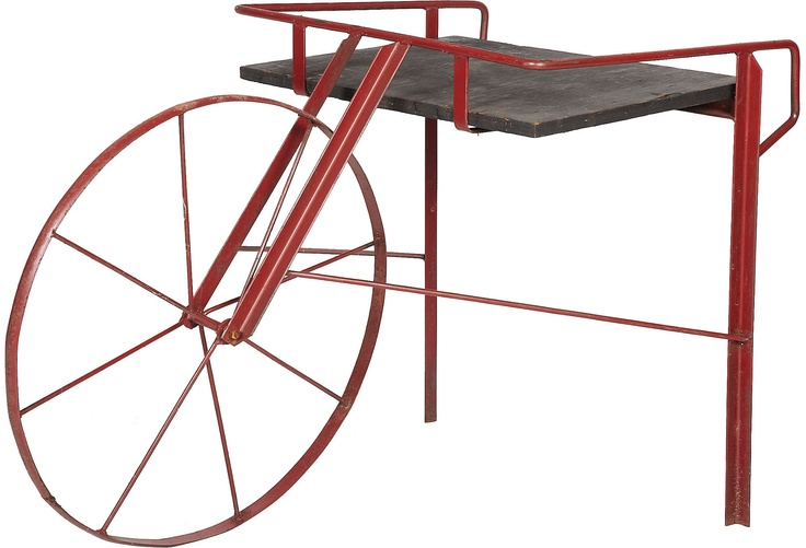 Midcentury metal wheelbarrow table. Now there's a conversation.