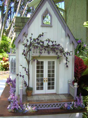 pretty purple and white dollhouse