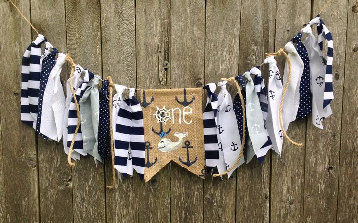 Found on Etsy! Nautical First Birthday High Chair Banner / Boy Birthday /Summer Party Theme/Navy & White/Sea Sailor Anchor Whale/Cake Smash Prop / Photo Shoot Backdrop / Party Decor This adorable navy and white nautical themed highchair banner would be perfect for your little one's birthday party, cake smash photos and first birthday photo shoot! Coordinating navy blue, white and gray fabrics and rope trims are cut by hand and tied onto jute twine.