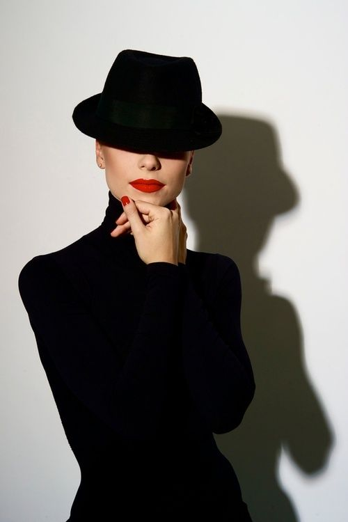 Never gets tired...classic black, red lips/nails. what a pic.