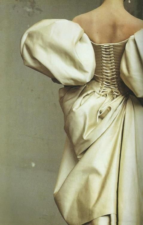 A duchesse satin dress by Christian Lacroix photographed by Irving Penn for Vogue (July 1995).