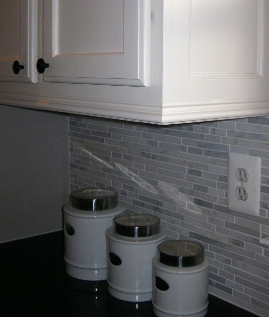 Adding moldings to your kitchen cabinets nice the o for Attaching crown molding to kitchen cabinets