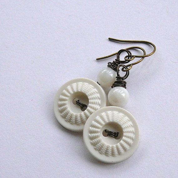 Textured White Vintage Button Dangle Earrings diy supplies: buttons: http://www.ecrafty.com/c-757-buttons.aspx jump rings: http://www.ecrafty.com/c-201-jump-rings-split-rings.aspx ear wires: http://www.ecrafty.com/c-153-earring-wires.aspx