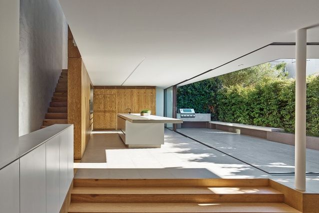 In the Birchgrove House, the timber floor of the living area appears to morph into joinery in the kitchen.