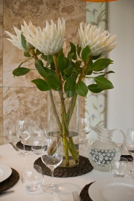 Proteas in vase with art deco jug