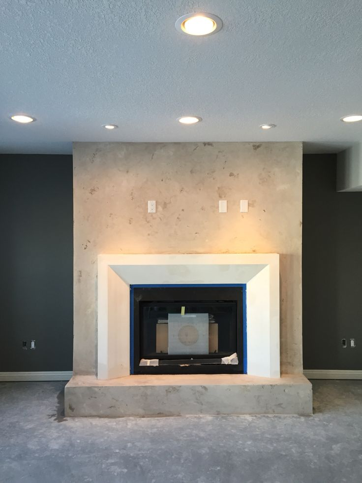 Custom Limestone Coating   Travertine Finish & Custom designed Fireplace Surround www.crownplaster.com