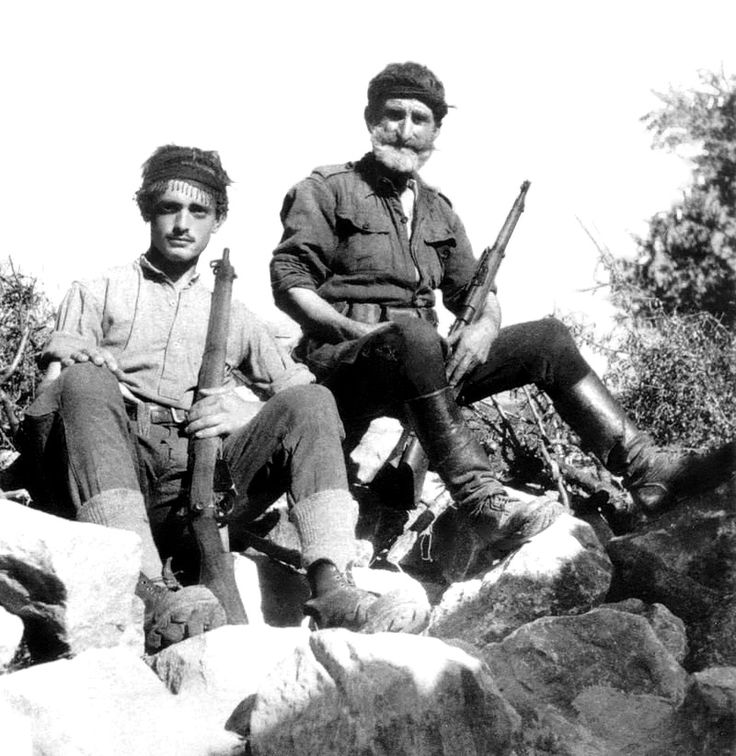 Cretan partisans pose for a photograph following the Axis invasion of the Greek island. Part of the larger Greek Resistance, it began on 20 May 1941 when German Fallschirmjäger (paratroops) invaded the island in the Battle of Crete (German: Unternehmen Merkur, or, Operation Mercury). For the first time during the war, invading German forces faced in Crete a valiant and vicious backlash from the local civilian population. Civilians on Crete: men, women and even children, picked off Axis p...